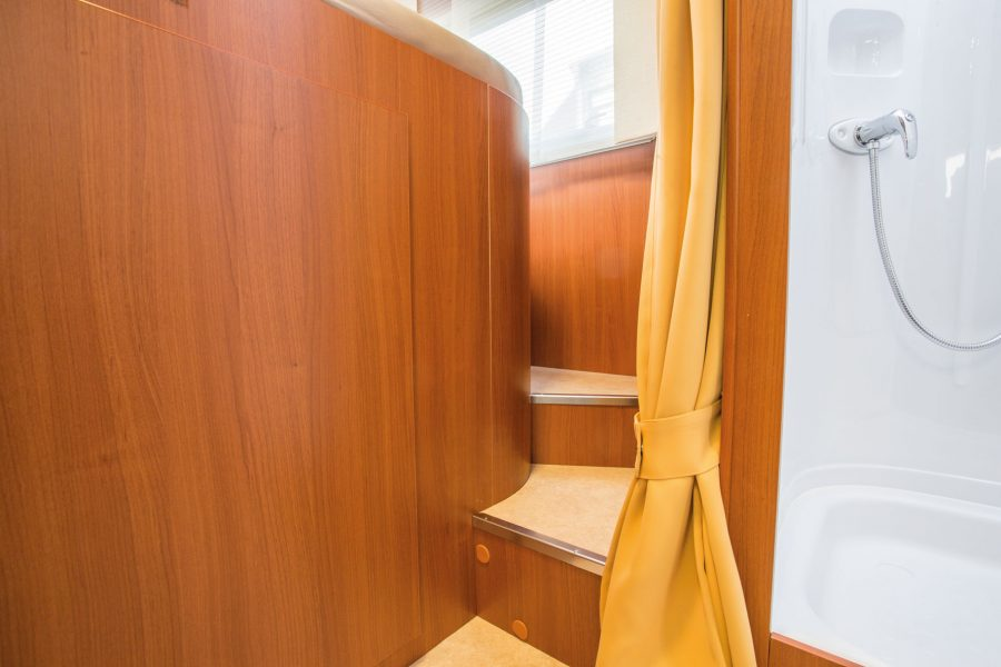 A staircase allows easy access to bed.